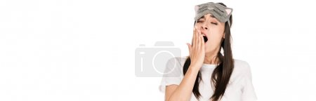 Photo for Brunette young woman in cat sleeping eye mask yawing isolated on white, panoramic shot - Royalty Free Image