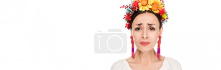 Photo for Upset brunette young woman in national Ukrainian embroidered shirt and floral wreath isolated on white, panoramic shot - Royalty Free Image