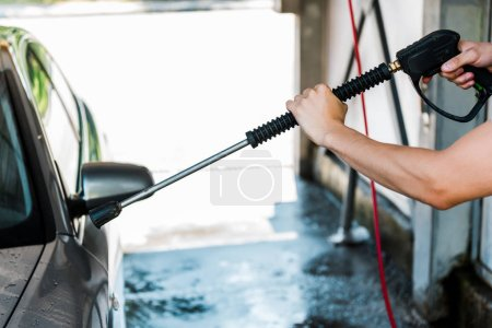 Photo for Cropped view of man washing grey auto outside - Royalty Free Image