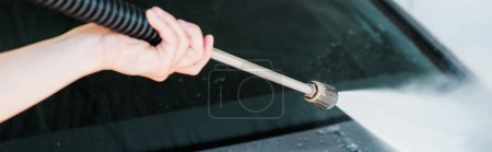 Photo for Panoramic shot of man washing modern automobile outside - Royalty Free Image
