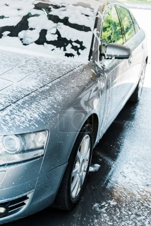 Photo for Selective focus of grey car with white foam in car wash - Royalty Free Image
