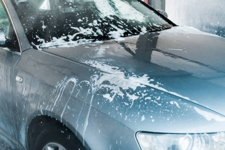 Photo for Selective focus of grey auto with white foam in car wash - Royalty Free Image