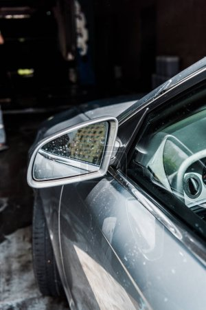 Photo for Selective focus of dirty car mirror of grey automobile - Royalty Free Image