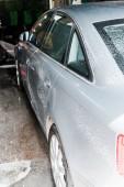 """Постер, картина, фотообои """"selective focus of grey vehicle with white foam in car wash """""""