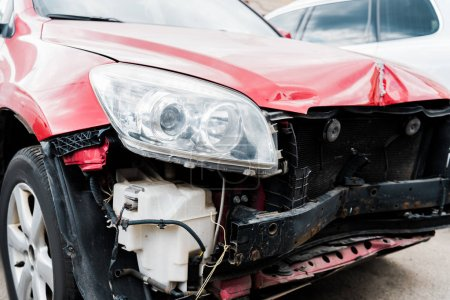 Photo for Selective focus of damaged red automobile after car accident - Royalty Free Image