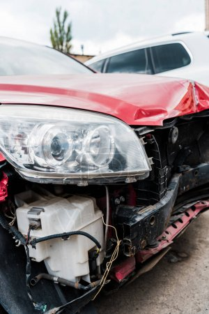 Photo for Selective focus of damaged red vehicle after car accident - Royalty Free Image