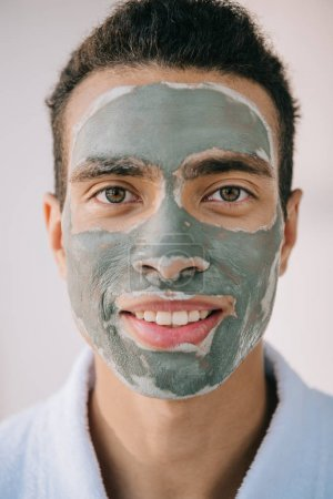 Photo for Portrait shot of handsome man with grey face mask smiling and looking at camera - Royalty Free Image
