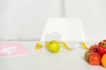 Photo for Folder, measure tape and fresh fruits and vegetables on table - Royalty Free Image