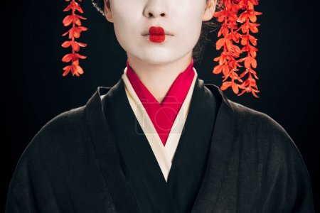 Photo for Partial view of beautiful geisha in black and red kimono isolated on black - Royalty Free Image
