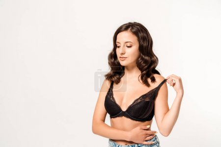 Photo for Attractive young woman touching lace bra on white - Royalty Free Image
