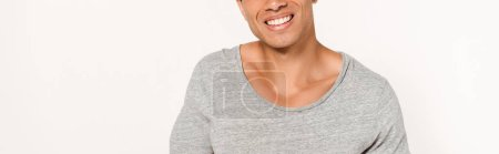 Photo for Panoramic shot of happy mixed race man smiling on white - Royalty Free Image