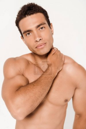 Photo for Handsome and muscular mixed race man touching neck on white - Royalty Free Image