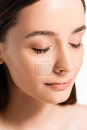 portrait of beautiful young woman with perfect skin and closed eyes isolated on white