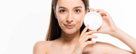 Photo for Beautiful smiling naked woman with perfect skin holding cosmetic cream isolated on white - Royalty Free Image