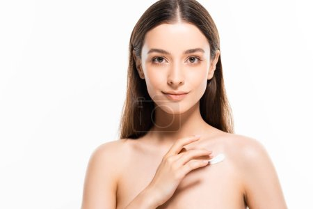 Photo for Beautiful naked woman with perfect skin applying cosmetic cream on skin isolated on white - Royalty Free Image