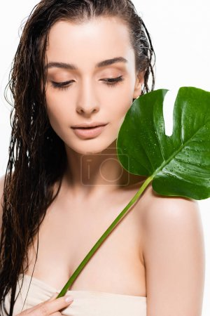 Photo for Beautiful wet young woman holding green palm leaf with water drops isolated on white - Royalty Free Image