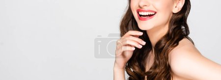 Photo for Cropped view of beautiful nude brunette woman with curls and makeup laughing isolated on grey - Royalty Free Image