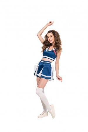Photo pour Sexy heureux cheerleader fille en uniforme bleu posant isolé sur blanc - image libre de droit
