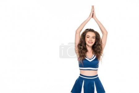 Photo pour Fille heureuse de pom-pom girl dans l'uniforme bleu applaudissant des mains d'isolement sur le blanc - image libre de droit