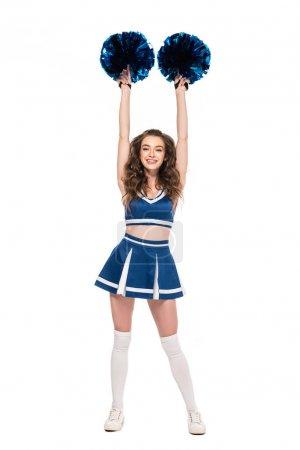Foto de Vista completa de sexy chica animadora feliz en uniforme azul bailando con pompones aislados en blanco - Imagen libre de derechos