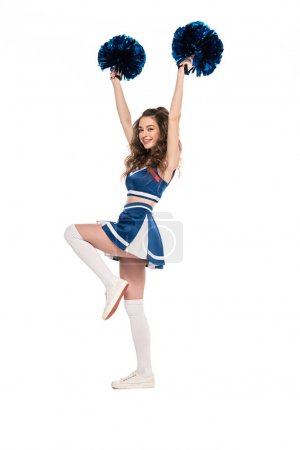 Photo for Full length view of happy cheerleader girl in blue uniform dancing with pompoms isolated on white - Royalty Free Image
