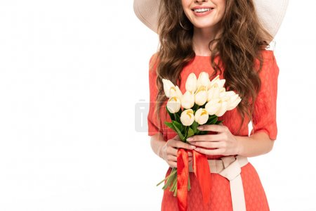 Photo for Cropped view of happy elegant woman in hat and dress holding tulips bouquet isolated on white - Royalty Free Image
