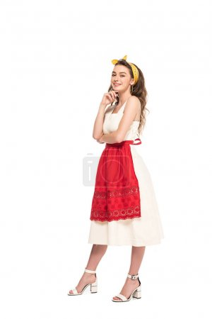 Photo for Full length view of happy young housewife in dress and apron posing isolated on white - Royalty Free Image