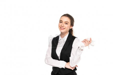 happy young waitress in formal wear holding white gloves isolated on white