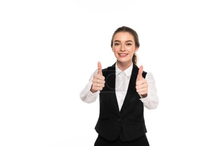 Photo for Happy young waitress showing thumbs up isolated on white - Royalty Free Image