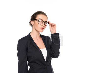 young successful businesswoman in black suit and glasses isolated on white