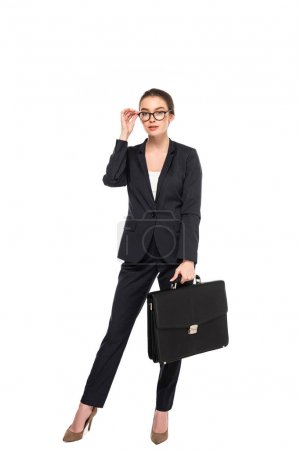 Photo for Full length view of young successful businesswoman in black suit and glasses with briefcase isolated on white - Royalty Free Image