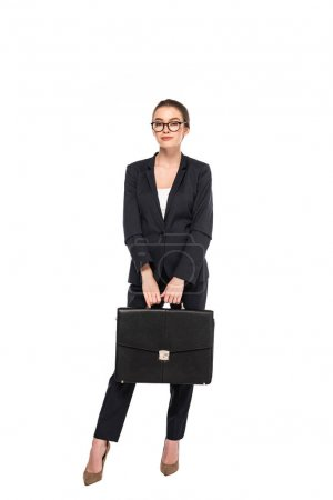 Photo for Full length view of young businesswoman in black suit and glasses with briefcase isolated on white - Royalty Free Image