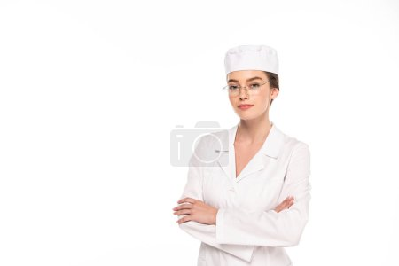 Photo for Young doctor in white coat with crossed arms isolated on white - Royalty Free Image