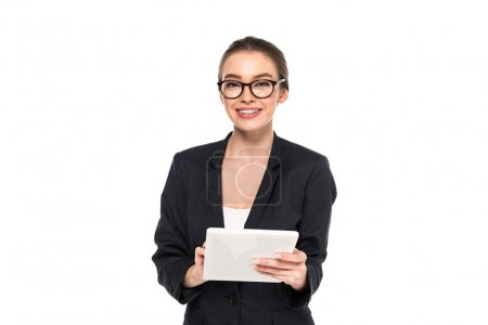 Photo for Young happy successful businesswoman in black suit and glasses using digital tablet isolated on white - Royalty Free Image