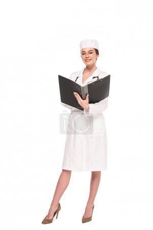 Photo for Full length view of young smiling doctor in white coat with stethoscope and folder isolated on white - Royalty Free Image