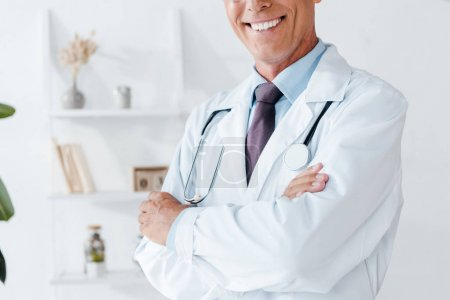 Photo for Cropped view of happy doctor in white coat with crossed arms - Royalty Free Image