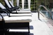 """Постер, картина, фотообои """"sun beds near swimming pool with railings on resort"""""""