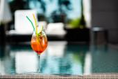 "Постер, картина, фотообои ""selective focus of cocktail near swimming pool on resort with copy space"""