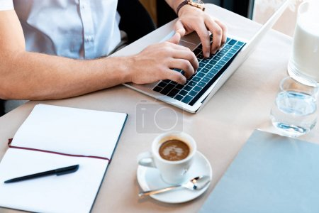 Photo for Partial view of freelancer typing on laptop keyboard in cafe - Royalty Free Image