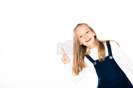 Photo for Cute, smiling schoolgirl showing idea sign while looking at camera isolated on white - Royalty Free Image