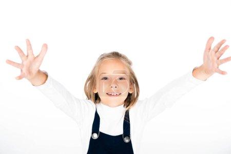 Foto de Colegiala alegre mostrando tiza manchada de las manos mientras sonríe a la cámara aislada en blanco - Imagen libre de derechos