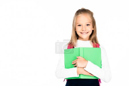 Photo for Adorable, cheerful schoolgirl holding book and smiling at camera isolated on white - Royalty Free Image
