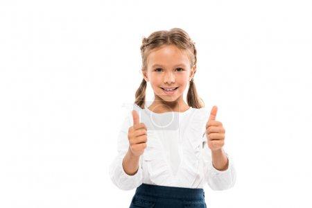 Foto de Niño alegre mostrando pulgares hacia arriba aislados en blanco - Imagen libre de derechos
