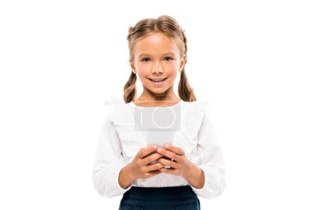 Photo for Cheerful child using smartphone isolated on white - Royalty Free Image