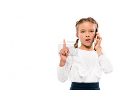 Photo for Cute kid having idea while talking on smartphone isolated on white - Royalty Free Image