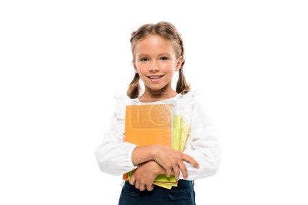 Photo pour Joyeux schoolkid retenant des livres d'isolement sur le blanc - image libre de droit