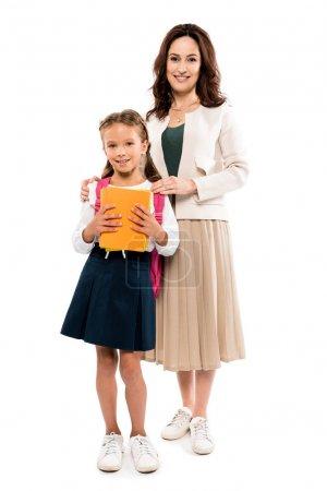 Photo pour Mère heureuse debout avec fille isolée sur blanc - image libre de droit