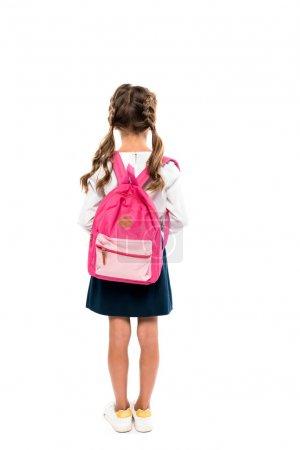 Photo pour Vue arrière de l'écolier debout avec sac à dos rose isolé sur blanc - image libre de droit