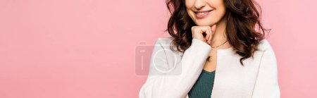 Photo for Panoramic shot of woman touching face isolated on pink - Royalty Free Image