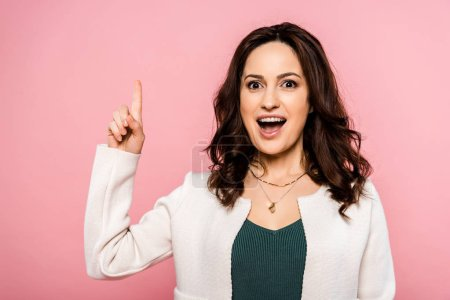 Photo for Excited woman having idea and gesturing isolated on pink - Royalty Free Image